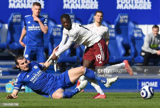 Nicolas Pepe of Arsenal is challenged by Caglar Soyuncu of Leicester during the Premier League match between Leicester City and Arsenal at The King...