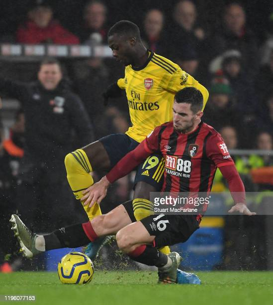 Nicolas Pepe of Arsenal is fouled by Lewis Cook of Bournemouth during the Premier League match between AFC Bournemouth and Arsenal FC at Vitality...