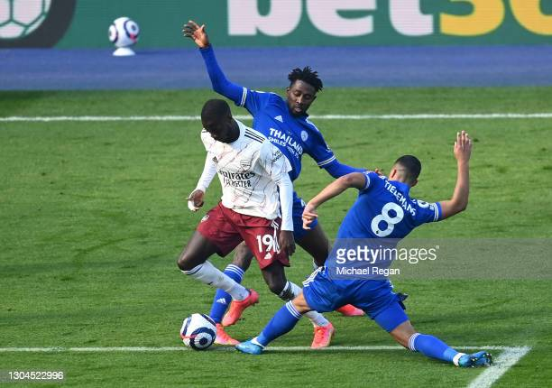 Nicolas Pepe of Arsenal is fouled by Wilfred Ndidi and Youri Tielemans of Leicester City leading to a penalty being awarded which is later overturned...