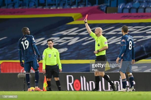 Nicolas Pepe of Arsenal is shown a red card by Match Referee Anthony Taylor during the Premier League match between Leeds United and Arsenal at...