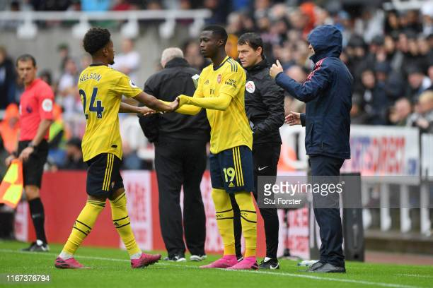Nicolas Pepe of Arsenal is substituted on for Reiss Nelson of Arsenal for his debut during the Premier League match between Newcastle United and...
