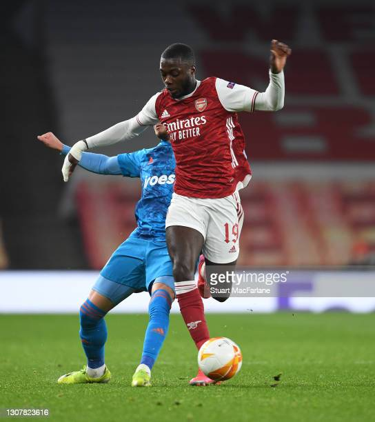 Nicolas Pepe of Arsenal Oleg Reabciuk of Olympiacos during the UEFA Europa League Round of 16 Second Leg match between Arsenal and Olympiacos at...