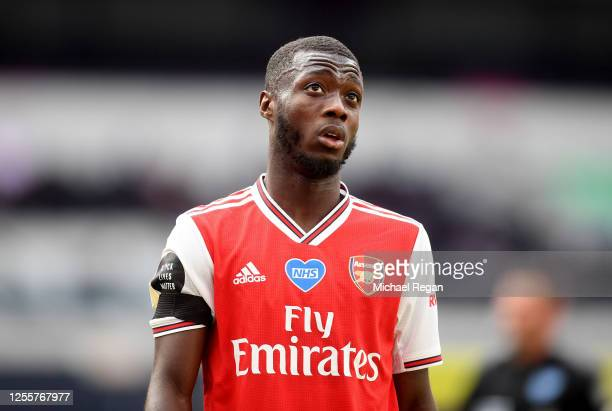 Nicolas Pepe of Arsenal reacts during the Premier League match between Tottenham Hotspur and Arsenal FC at Tottenham Hotspur Stadium on July 12, 2020...