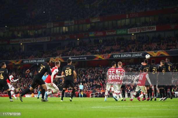Nicolas Pepe of Arsenal scores a goal to make it 3-2 during the UEFA Europa League group F match between Arsenal FC and Vitoria Guimaraes at Emirates...