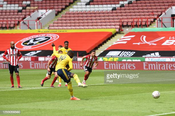 Nicolas Pepe of Arsenal scores his sides first goal from the penalty spot during the FA Cup Fifth Quarter Final match between Sheffield United and...