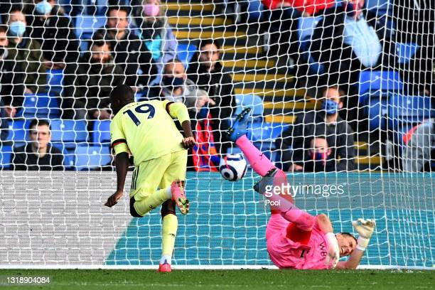 Nicolas Pepe of Arsenal scores his team's first goal during the Premier League match between Crystal Palace and Arsenal at Selhurst Park on May 19,...