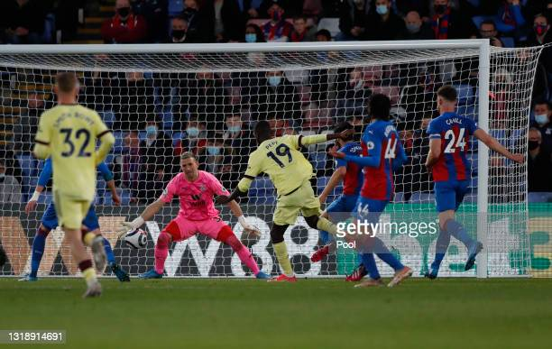 Nicolas Pepe of Arsenal scores his team's third goal during the Premier League match between Crystal Palace and Arsenal at Selhurst Park on May 19,...