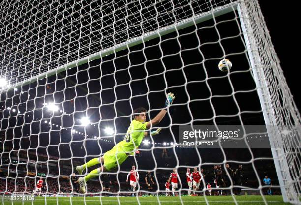 Nicolas Pepe of Arsenal scores his team's third goal past Miguel Silva of Vitoria Guimaraes during the UEFA Europa League group F match between...