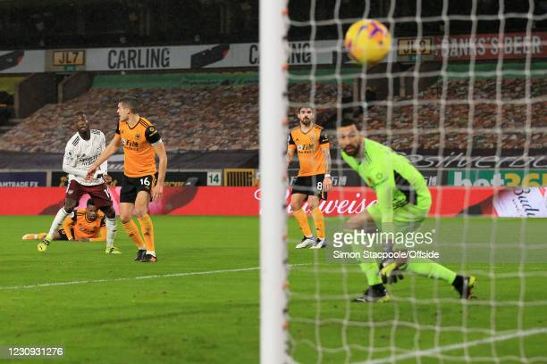 Nicolas Pepe of Arsenal scores the opening goal during the Premier League match between Wolverhampton Wanderers and Arsenal at Molineux on February...