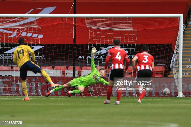 Nicolas Pepe of Arsenal scores the opening goal from the penalty spot during the FA Cup Fifth Quarter Final match between Sheffield United and...