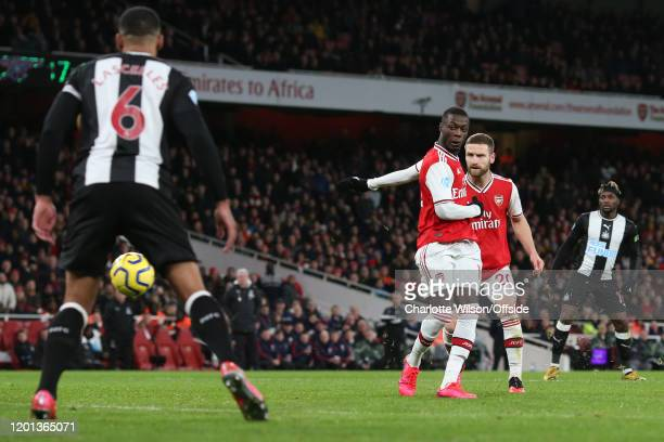 Nicolas Pepe of Arsenal scores their 2nd goal during the Premier League match between Arsenal FC and Newcastle United at Emirates Stadium on February...