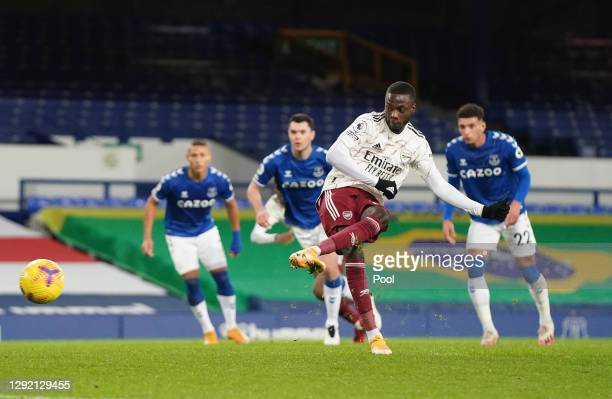 Nicolas Pepe of Arsenal scores their sides first goal from the penalty spot during the Premier League match between Everton and Arsenal at Goodison...