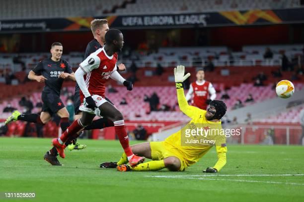 Nicolas Pepe of Arsenal scores their side's first goal past Ondrej Kolar of Slavia Praha during the UEFA Europa League Quarter Final First Leg match...