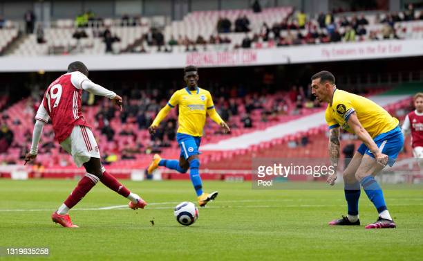 Nicolas Pepe of Arsenal scores their team's second goal during the Premier League match between Arsenal and Brighton & Hove Albion at Emirates...