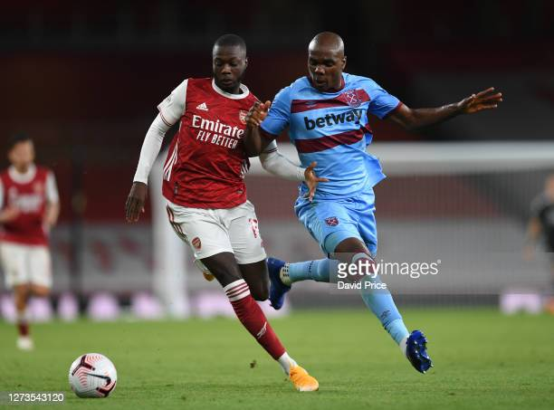 Nicolas Pepe of Arsenal takes on Angelo Ogbonna of West Ham during the Premier League match between Arsenal and West Ham United at Emirates Stadium...