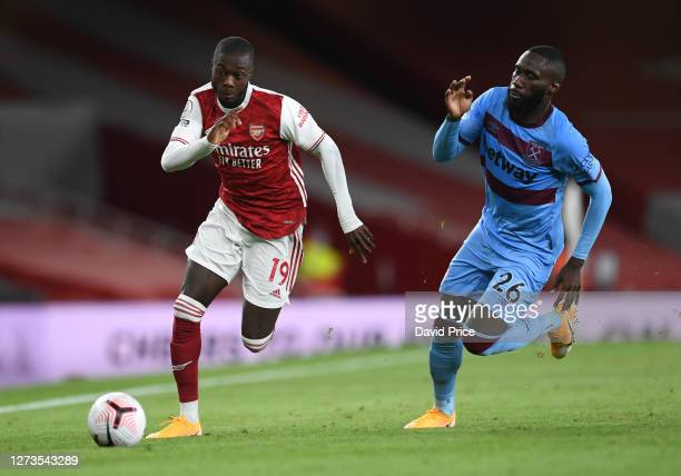 Nicolas Pepe of Arsenal takes on Arthur Masuaka of West Ham during the Premier League match between Arsenal and West Ham United at Emirates Stadium...