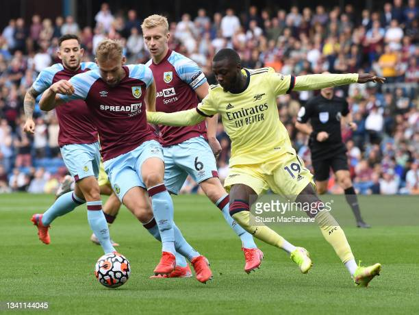 Nicolas Pepe of Arsenal takes on Charlie Taylor of Burnley during the Premier League match between Burnley and Arsenal at Turf Moor on September 18,...