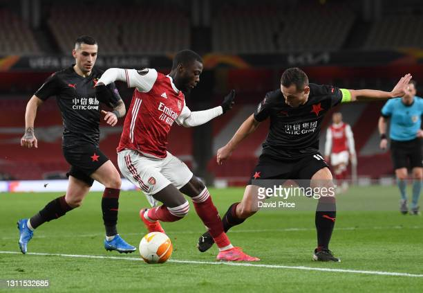 Nicolas Pepe of Arsenal takes on Jan Boril and Nicolae Stanciu of Slavia during the UEFA Europa League Quarter Final First Leg match between Arsenal...
