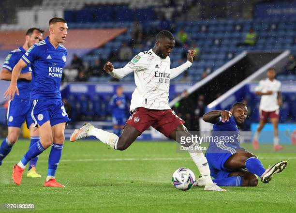 Nicolas Pepe of Arsenal takes on Luke Thomas and Wes Morgan of Leicester during the Carabao Cup Third Round match between Leicester City and Arsenal...