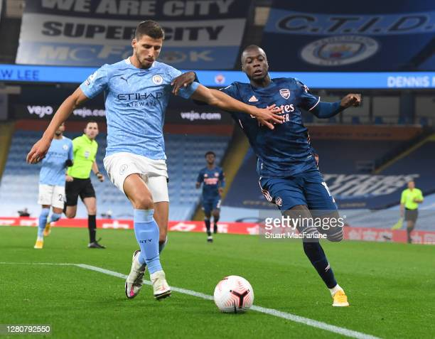 Nicolas Pepe of Arsenal takes on Ruben Dias of Man City during the Premier League match between Manchester City and Arsenal at Etihad Stadium on...