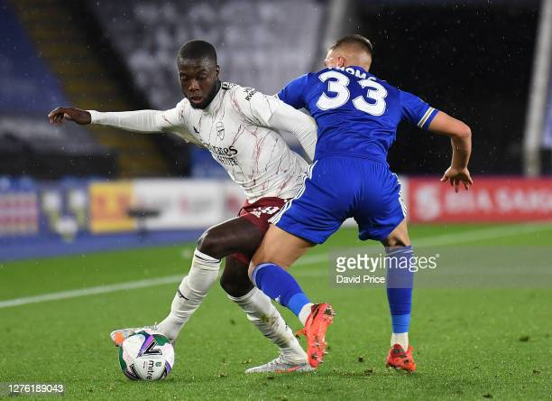 Nicolas Pepe of Arsenal turns away from Luke Thomas of Leicester during the Carabao Cup Third Round match between Leicester City and Arsenal at The...