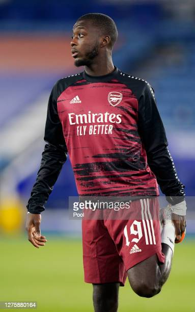 Nicolas Pepe of Arsenal warms up ahead of the Carabao Cup third round match between Leicester City and Arsenal at The King Power Stadium on September...