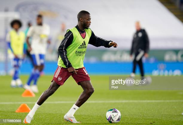 Nicolas Pepe of Arsenal warms up prior to the Carabao Cup third round match between Leicester City and Arsenal at The King Power Stadium on September...