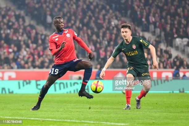Nicolas Pepe of Lille and Aleksandr Golovin of Monaco during the Ligue 1 match between Lille and Monaco at Stade Pierre Mauroy on March 15 2019 in...