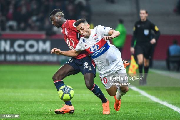 Nicolas Pepe of Lille and Fernando Marcal of Lyon during the Ligue 1 match between Lille OSC and Olympique Lyonnais at Stade Pierre Mauroy on...