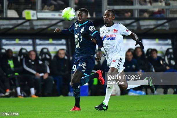Nicolas Pepe of Lille and Khaled Adenon of Amiens during the rescheduled Ligue 1 match between Amiens SC and Lille OSC at Stade de la Licorne on...