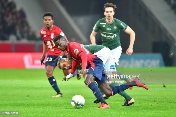 Nicolas Pepe of Lille and Loic Perrin of St Etienne during the Ligue 1 match between Lille OSC and AS SaintEtienne at Stade Pierre Mauroy on November...