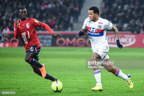 Nicolas Pepe of Lille and Memphis Depay of Lyon during the Ligue 1 match between Lille OSC and Olympique Lyonnais at Stade Pierre Mauroy on February...