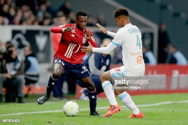 Nicolas Pepe of Lille Boubacar Kamara of Olympique Marseille during the French League 1 match between Lille v Olympique Marseille at the Stade Pierre...