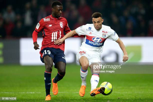 Nicolas Pepe of Lille Fernando Marcal of Olympique Lyon during the French League 1 match between Lille v Olympique Lyon at the Stade Pierre Mauroy on...