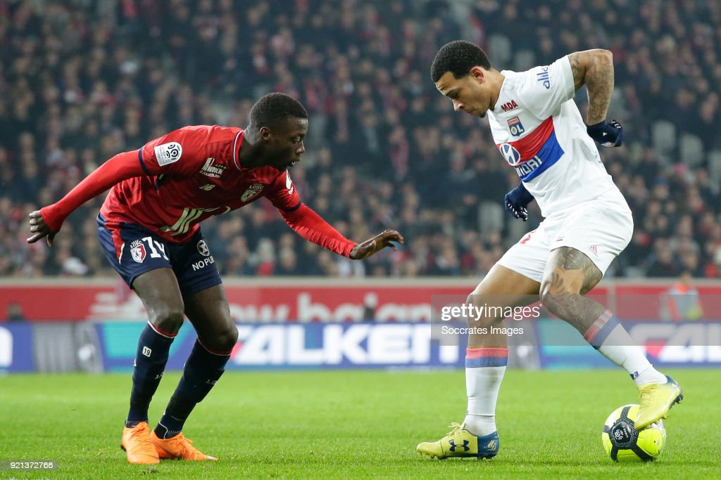 Nicolas Pepe of Lille, Memphis Depay of Olympique Lyon during the French League 1 match between Lille v Olympique Lyon at the Stade Pierre Mauroy on February 18, 2018 in Lille France