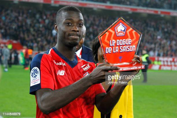 Nicolas Pepe of Lille receive the fans year trophy after the Ligue 1 match between Lille and Angers on May 18 2019 in Lille France