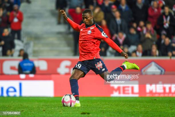 Nicolas Pepe of Lille scores a penalty during the Ligue 1 match between Lille and Reims at Stade Pierre Mauroy on December 9, 2018 in Lille, France.