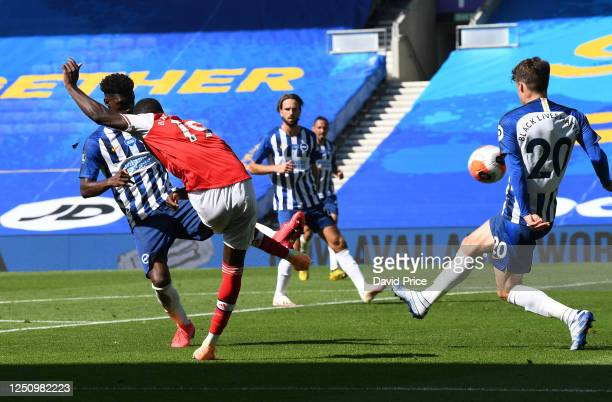 Nicolas Pepe scores a goal for Arsenal during the Premier League match between Brighton & Hove Albion and Arsenal FC at American Express Community...