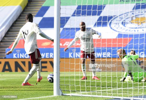 Nicolas Pepe scores Arsenal's 3rd goal during the Premier League match between Leicester City and Arsenal at The King Power Stadium on February 28,...