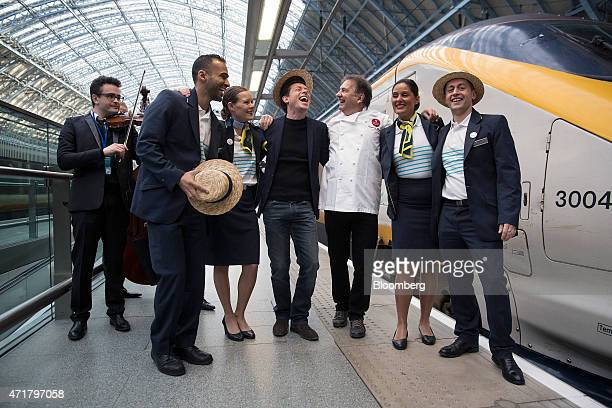 Nicolas Petrovic chief executive officer of Eurostar International Ltd center and Raymond Blanc a Michelinstarred chef third right pose for a...