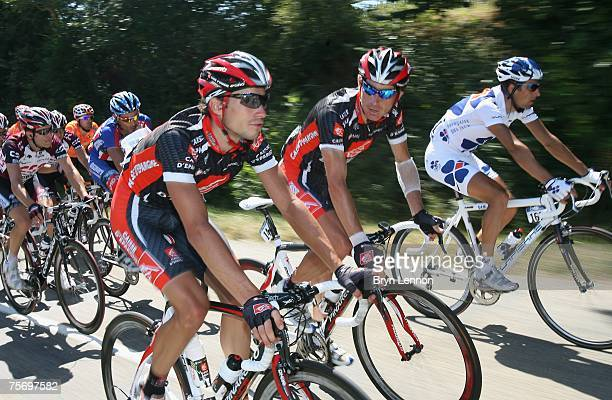 Nicolas Portal of France and Caisse D'Epargne chats to team mate Jose Ivan Gutierrez of of Spain and Team CSC on stage 17 of the 2007 Tour de France...