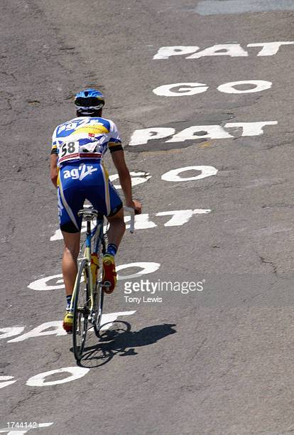Nicolas Portal of the AG2R Prevoyance team rides over painted words of encouragement to Australian cyclist Patrick Jonker as he leads the way up...