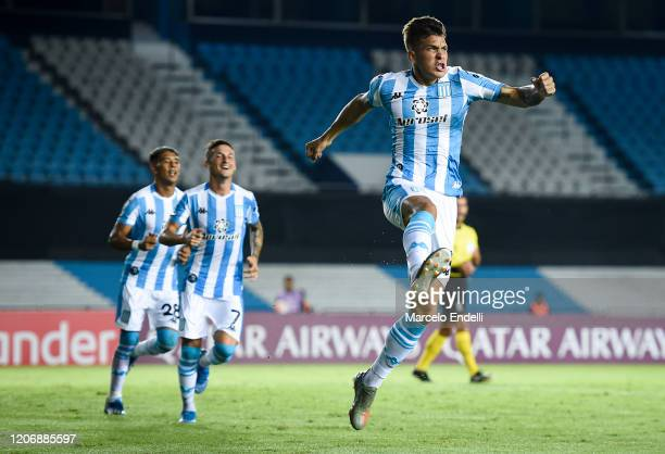 Nicolas Reniero of Racing Club celebrates after scoring the first goal of his team during a Group F match between Racing Club and Alianza Lima as...