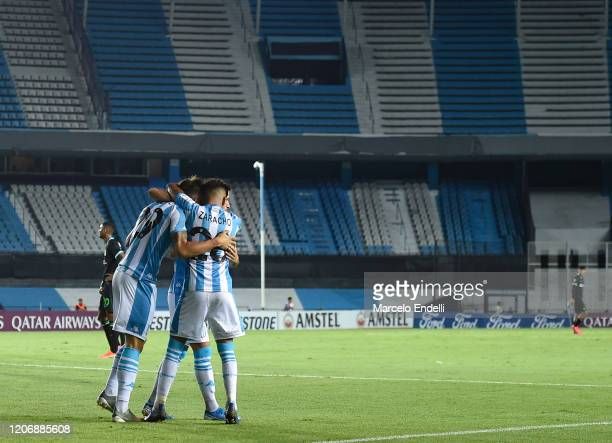 Nicolas Reniero of Racing Club celebrates with teammates after scoring the first goal of his team during a Group F match between Racing Club and...