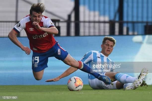 Nicolas Reniero tackles Alfonso Trezza of Nacional during a group F match of Copa CONMEBOL Libertadores 2020 between Racing and Nacional at Juan...