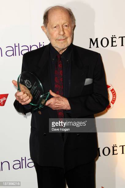 Nicolas Roeg poses with his Excellence In Film Award in the press room at the London Film Critics' Circle Awards 2012 at The BFI Southbank on January...