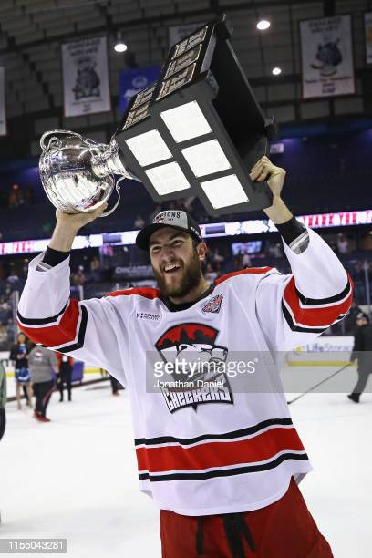 Nicolas Roy of the Charlotte Checkers holds the Calder Cup trophy after a win over the Chicago Wolves during game Five of the Calder Cup Finals at...