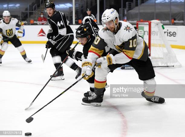 Nicolas Roy of the Vegas Golden Knights and Blake Lizotte of the Los Angeles Kings turn for the puck during the first period at Staples Center on...