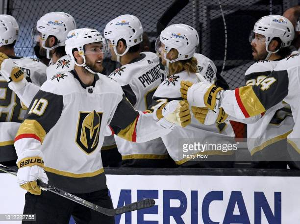 Nicolas Roy of the Vegas Golden Knights celebrates his goal with the bench, to trail 2-1 to the Los Angeles Kings, during the second period at...