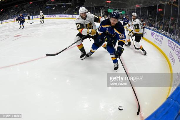 Nicolas Roy of the Vegas Golden Knights pressures Vladimir Tarasenko of the St. Louis Blues on April 7, 2021 at the Enterprise Center in St. Louis,...